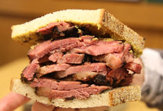 Famous Pastrami on rye sandwich served in New York Deli Stock Photo
