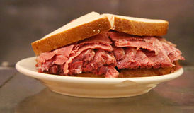 Famous Pastrami on rye sandwich served in New York Deli Stock Photos