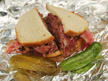 Famous Pastrami on rye sandwich served with pickles in New York Deli Stock Images