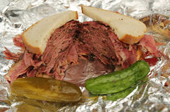 Famous Pastrami on rye sandwich served with pickles in New York Deli Royalty Free Stock Image
