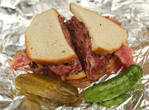Famous Pastrami on rye sandwich served with pickles in New York Deli Stock Photos