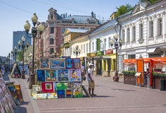 Famous pedestrian Arbat Street in Moscow, Russia. MOSCOW, RUSSIA - MAY 25, 2010: Street artists sell paintings to the tourists on the street market at the famous Stock Image