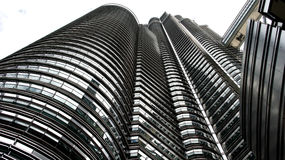 Famous Petronas Twin Towers from worm`s-eye view Stock Images