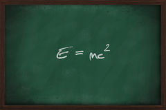 Famous physics equation on blackboard Stock Photo