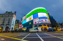Famous Piccadilly Circus in London. Famous Piccadilly Circus neon signage shines at night. These signs have become a major attraction of London in London, United Royalty Free Stock Image