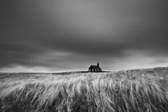 Famous picturesque black church of Budir at Snaefellsnes peninsula region in Iceland during a heavy windy weather. royalty free stock images