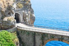 Road of Amalfi coast, Italy. Famous picturesque winding road and viaduct of Amalfi summer coast, Italy Royalty Free Stock Images