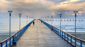 Famous pier in Palanga, Lithuania. Sunrise at the famous marine pier in resort city of Palanga, Lithuania, Europe royalty free stock photos