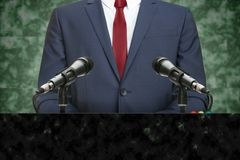 Famous politician making speech behind the pulpit. Powerful politician making speech from behind the pulpit Royalty Free Stock Photo