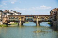 Famous Ponte Vecchio bridge over the Arno river in Florence, Italy.  Royalty Free Stock Photos