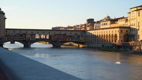 Famous Ponte Vecchio with river Arno in Florence. Italy stock footage
