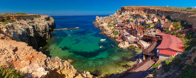 Famous Popeye Village at Anchor Bay, Malta. Aeril panorama of Popeye Village in the sunny day, Malta Royalty Free Stock Photography