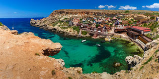 Famous Popeye Village at Anchor Bay, Malta. Aeril panorama of Popeye Village in the sunny day, Malta Stock Photo