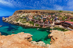 Famous Popeye Village at Anchor Bay, Malta. Aeril panorama of Popeye Village in the sunny day, Malta Stock Images