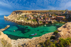 Famous Popeye Village at Anchor Bay, Malta. Aeril panorama of Popeye Village in the sunny day, Malta Stock Photos