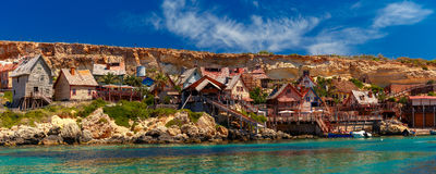 Famous Popeye Village at Anchor Bay, Malta. Panorama of Popeye Village in the sunny day, Malta Royalty Free Stock Photography