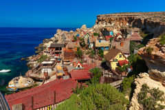 Famous Popeye Village at Anchor Bay, Malta. Popeye Village in the sunny day, Malta Stock Images