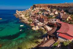 Famous Popeye Village at Anchor Bay, Malta. Traditional colorful houses in the famous Popeye Village at Anchor Bay, Il-Mellieha, Malta Stock Photo