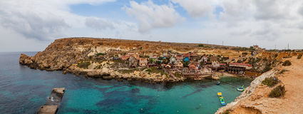 Famous Popeye village in Malta. Azure bay in the rocks. Famous Popeye village in Malta. Azure bay in the rocks Stock Images
