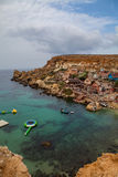 Famous Popeye village in Malta. Azure bay in the rocks. Famous Popeye village in Malta. Azure bay in the rocks Royalty Free Stock Images