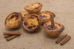 Famous Portuguese egg pastry tart. Called 'Pastel de Belem' on hessian fabric Royalty Free Stock Photos