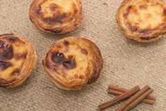 Famous Portuguese egg pastry tart. Called 'Pastel de Belem' on hessian fabric Stock Photos