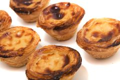 Famous Portuguese egg pastry tart. Called 'Pastel de Belem' isolated on white background Royalty Free Stock Photography