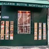 The famous poster of Le Chat Noir, the black cat, and other pictures in Montmartre, Paris Royalty Free Stock Photo