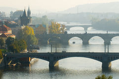 Famous Prague. This is a general view of Prague in autumn. Famous bridges across Vltava river are blotted out by the fog Stock Images