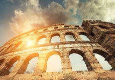 Famous Pula Amphitheatre in Croatia with dramatic sky stock images