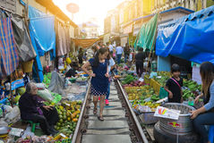 The famous railway market or folding umbrella market at Maeklong, Thailand, A famous market in Thailand and sixth times a day the Stock Photos