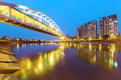 The famous Rainbow Bridge over Keelung River with reflections on smooth water at dusk in Taipei, Taiwan Asia. ~A romantic landmark of Taipei, the capital city Royalty Free Stock Photography