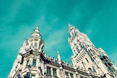 Famous Rathaus Town Hall in Marienplatz on the unreal sky. Fragment. Munich, Germany stock image