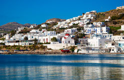 Famous red boat and church in the bay of Mykonos Stock Image