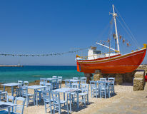 The famous red boat and a tavern on island Stock Photography