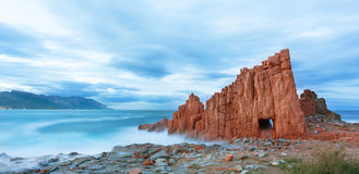 Famous Red Rock in Arbatax, Sardinia Italy. Red rocks and turquoise water of Arbatax, Sardinia, italy Stock Photo