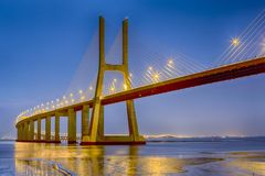 Famous and Renowned Picturesque Vasco Da Gama Bridge in Lisbon. In Portugal. Picture Made During Blue Hour. Horizontal Image stock photos