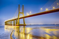 Famous and Renowned Picturesque Vasco Da Gama Bridge in Lisbon. In Portugal. Picture Made During Blue Hour. Horizontal Image Composition stock photos