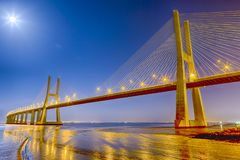Famous and Renowned Picturesque Vasco Da Gama Bridge in Lisbon. In Portugal. Picture Made At Night time. Horizontal Image Composition royalty free stock photography