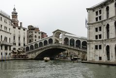 The famous Rialto Bridge Ponte di Rialto is one of the four bridges spanning the Grand Canal in Venice Stock Photo