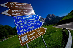 Famous road ascend to Alpe di Siusi peak. Road signs showing directions to famous peak of Alpe di Siusi panorama. Iconic road bike ascend stock photo