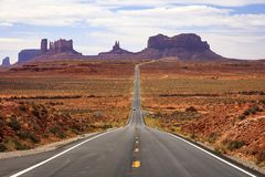 Famous road into Monument Valley, Utah, USA. Famous road in a desert canyon landscape, Utah, USA royalty free stock photo