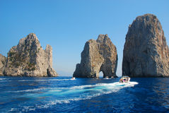 Famous rocks of Capri island. Faraglioni rocks, Isle of capri, Italy Royalty Free Stock Photos