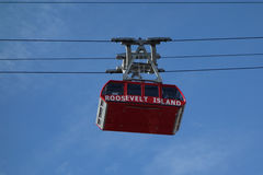 The famous The Roosevelt Island Tramway in New York. NEW YORK - MARCH 30 , 2017: The famous The Roosevelt Island Tramway that spans the East River and connects Royalty Free Stock Image