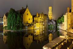 Rozenhoedkaai In Bruges At Night. The famous Rozenhoedkaai in Bruges with misty night sky Royalty Free Stock Photo