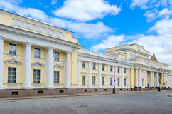 Famous Russian Ethnographic Museum, St. Petersburg, Russia. SAINT PETERSBURG, RUSSIA - MAY 4, 2017: Unknown people are walking along street near famous Russian Stock Images