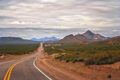 Highway road through Argentinia. Famous Ruta 40 called also Ruta Quarenta passing through some impressive and strangely shaped mountains in northern part of the Royalty Free Stock Photos