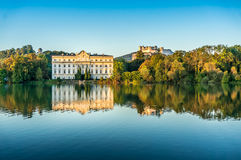 Famous Schloss Leopoldskron with Hohensalzburg Fortress in Salzburg at sunset, Austria royalty free stock photography