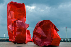Famous sculpture composition Rock Strangers. OSTEND, BELGIUM - OCTOBER 13, 2015: Famous sculpture composition Rock Strangers by Arne Quinze, placed on sea cliff Royalty Free Stock Photography