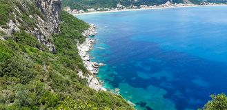 Porto Timoni, beach in Corfu. Famous 2 side Porto Timoni beach near Agios Georgios, Beautiful Paleokastritsa beach on Corfu, Cape Drastis with nearby islands royalty free stock photography